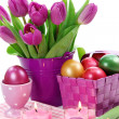 Purple tulips in bucket and easter eggs — Stock Photo