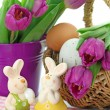 Purple tulips in bucket and two rabbits — Stock Photo