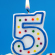 Stock Photo: Number five birthday candl