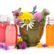 Stock Photo: Mortar with fresh flowers and essential oil