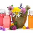 Mortar with fresh flowers and essential oil - Stock Photo