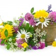 Mortar with fresh flowers - Stock Photo