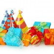 Colorful gift boxes and party hats — Stock Photo