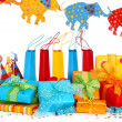 Colorful gift boxes and party hats - Stock Photo