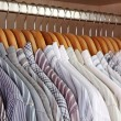 Stock Photo: Clothes hanger with man's shirts