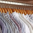 Clothes hanger with man's shirts — Stock Photo