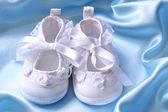 White baby booties — Stock Photo