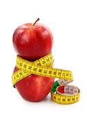 Dvě červená jablka a svinovací metr — Stock fotografie