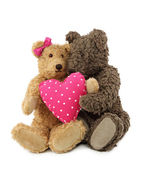 Two teddy bears with pink heart — Stock Photo