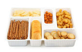 Salty snacks in box — Stock Photo