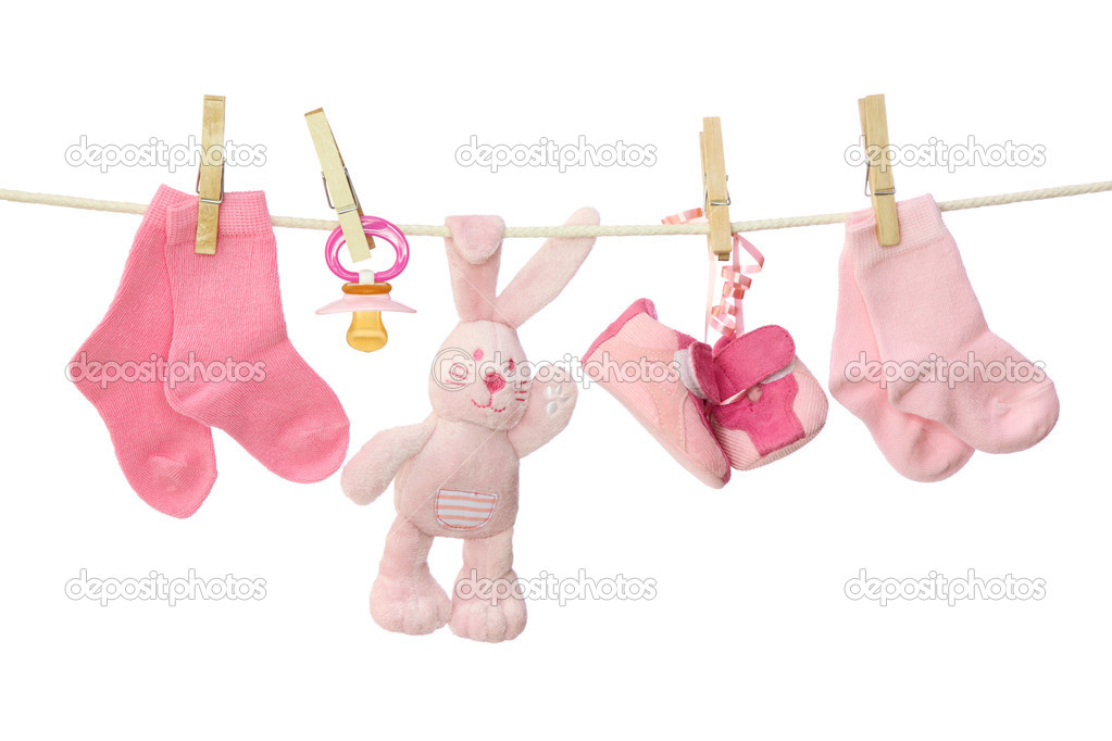 Pink baby goods hanging on the clothesline — Stock Photo #6037907