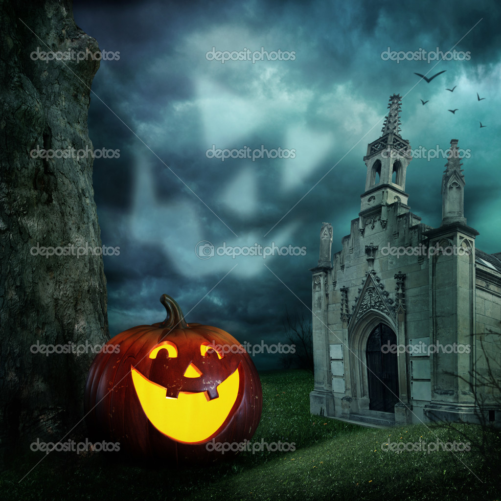 Halloween pumpkins and cemetery chapel at night — Stock Photo #6285265