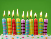 Ten colorful candles — Stockfoto