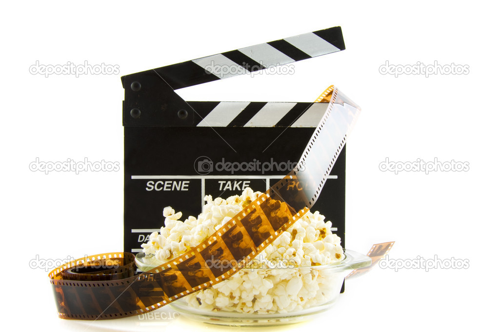 Clapper with popcorn and film isolated over white — Stock Photo #6098093