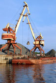 Two dock clamshell crane and barge — Stock Photo