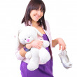 Girl and her teddy bunny — Stock Photo #6158547