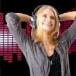 Pretty young girl enjoys listening music — Stock Photo