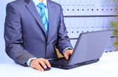 Close-up of male hand on mouse while working on laptop — Stock Photo