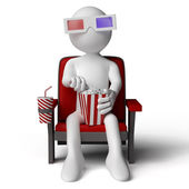 3D human sitting on a armchair in the cinema — Stock Photo