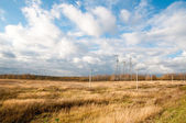 Beautiful autumn landscape with dry grass and clouds — Stock Photo