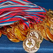 Many gold medals - Stock Photo