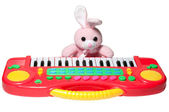 Pink bunny with synthesizer — Stock Photo