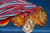 Many gold medals — Stock Photo