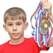 Boy-athlete with medals — Stock Photo