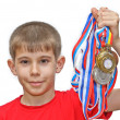 Boy-athlete with medals — Stock Photo #5673086