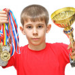 Boy-athlete with medals — Stock Photo #5673091