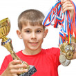 Boy-athlete with medals — Stock Photo #5673093