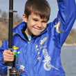A boy with a fishing pole caught small fish — Stock Photo #5673515