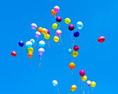 Many balloons fly into the sky — Stock Photo