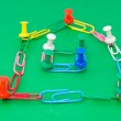 Colored paper clips and pins — Stock Photo