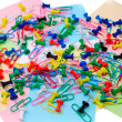Colored paper clips and pins - Stock Photo