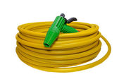 Hose for watering the garden with the spray — Stock Photo