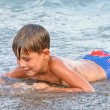 Boy playing in the surf — Stock Photo