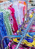 Rows of clothes on hangers — Stock Photo