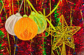Christmas decorations and tinsel in different colors — Stock Photo