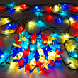 Garland of colored lights for Christmas trees - Stock Photo