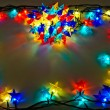 Garland of colored lights for Christmas trees — Stock Photo #6677984
