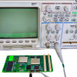 Oscilloscope and the board on a white background — Stock Photo