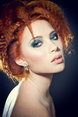 Face of a beautiful redhead woman with perfect makeup — Stock Photo