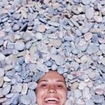 Funny girl in stones — Stock Photo #5469787