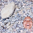 Funny girl in stones — Stock Photo #5469793
