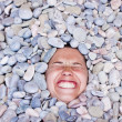 Funny girl in stones — Stock Photo