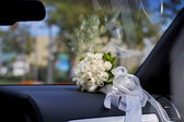 Wedding bouquet in the car — Stock Photo