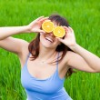 Young woman with an orange — Stock Photo #5598771