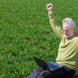 Stock Photo: Exciting grandfather with laptop
