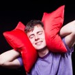 Stock Photo: Man sleeping between two pillows